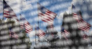 Flags reflected in Vietnam Memorial