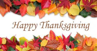 Happy Thanksgiving text with autumn leaves
