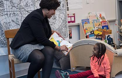 Mayor Bowser and little girl