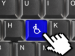 Closeup of keyboard with a wheelchair key being pressed