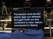 """Teleprompter in auditorium with """"Four Score"""" text displayed"""